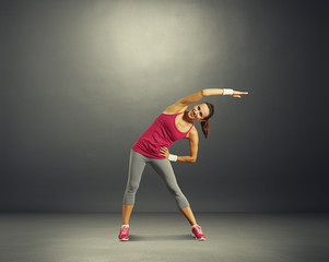 fitness woman over dark background