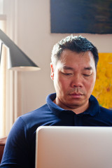 Chinese male on laptop