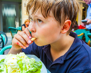 child is eating ice cream