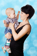 Beautiful happy mother with attractive baby boy
