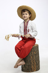 Boy in ethnic clothing with wheat
