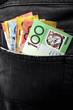 Australian money in black jeans back pocket