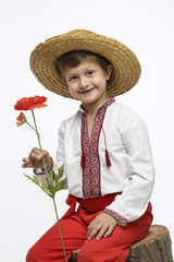 Smiling boy with a flower