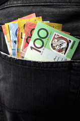 Australian money in black jeans back pocket