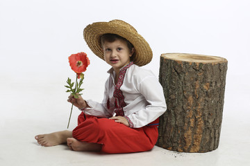 Boy in ethnic clothing with flower