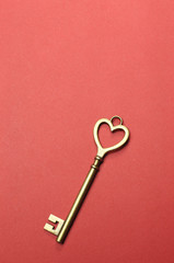 Heart shape key on red background
