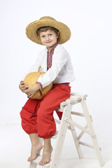 Farmer boy with a pumpkin