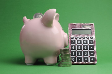 Piggy bank, stack of coins and calculator