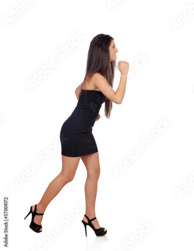Sensual brunette girl with black dress running