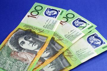 Three hundred Australian dollar notes on blue background.