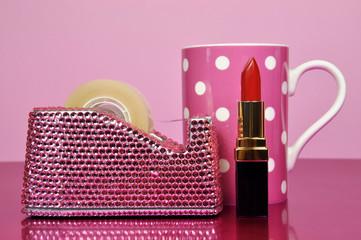 Pink feminine office desk, lipstick and coffee