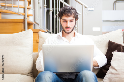 Man using a laptop in his apartment