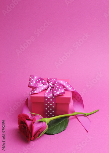 Pretty pink gift with pink rose bud, and copy space