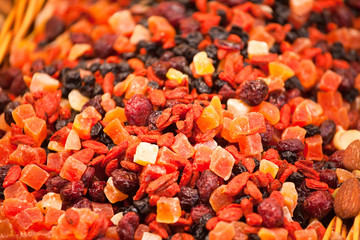 Scattering of different candied fruits on counter