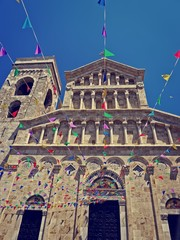 colorful garlands in front of an italian church i