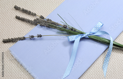 Sprigs of Lavender flower tied in blue polka dot ribbon