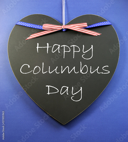 Happy Columbus Day message on heart shape blackboard