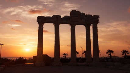 Ancient ruins of Roman Empire  against the sunset.