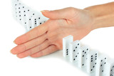 Hand stopping dominoes falling isolated on white
