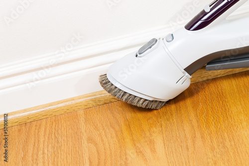 Cleaning Floor and Trim work with Vacuum Cleaner