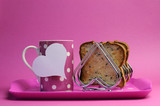 Pink theme breakfast tray with coffee cup and heart toast
