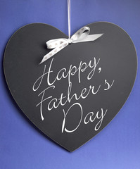 Happy Fathers Day message on blackboard