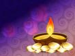 diwali diya with gold coins