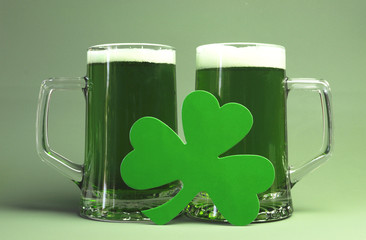 Happy St Patrick's Day with two steins of green beer.