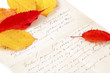 handwritten letter with autumn leaves