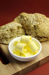Australian traditional damper bread with butter curls.