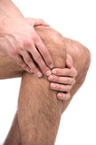Pain in a knee. Man suffering from knee pain
