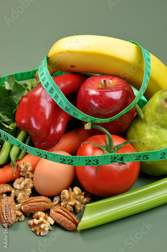Healthy diet with measuring tape for weight loss concept