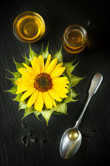 Sunflower oil, flower sunflower and seeds on the chalkboard