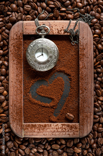 Ground coffee with coffee beans and vintage watches