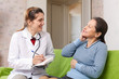 doctor asked happy female mature patient feels