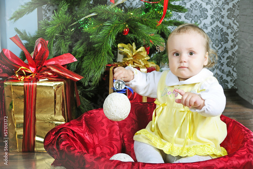 Small girl near new year's fir tree