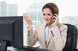 Unhappy businesswoman phoning