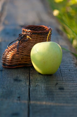 wicker toy clog and yellow apple