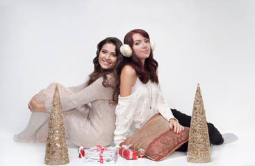 Two beautiful girls with christmas presents
