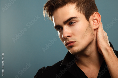 Trendy young man in black shirt, portrait of sexy fashion boy lo