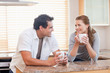 Couple enjoying coffee in the kitchen together