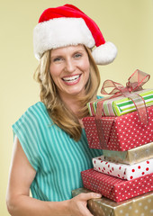 Woman Holding Stack Of Christmas Presents