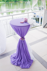 Table decorated with fabric