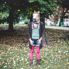 horse mask woman in the park
