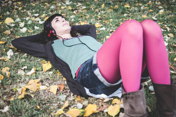 young beautiful woman listening to music autumn