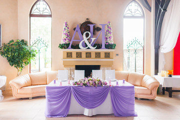 Bride and groom's table decorated with flowers