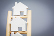 Model Houses On Rungs Of Wooden Property Ladder - 57023970