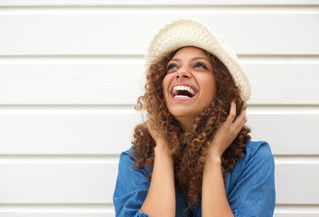 Portrait of a happy female fashion model laughing