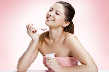 Exquisite woman with yogurt