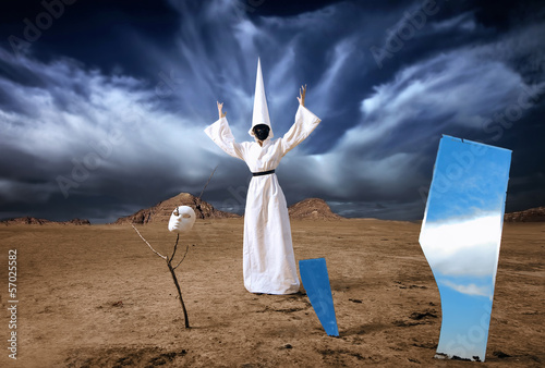 Strange figure in white cloak with mirrors in desert. Artwork